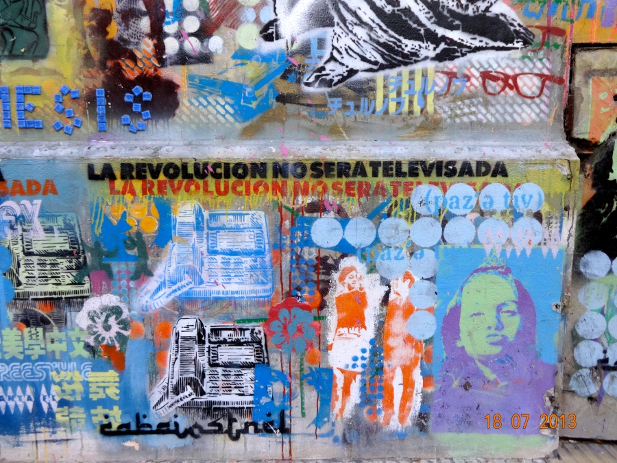 This wall was painted with layers and layers of stencil artworks.