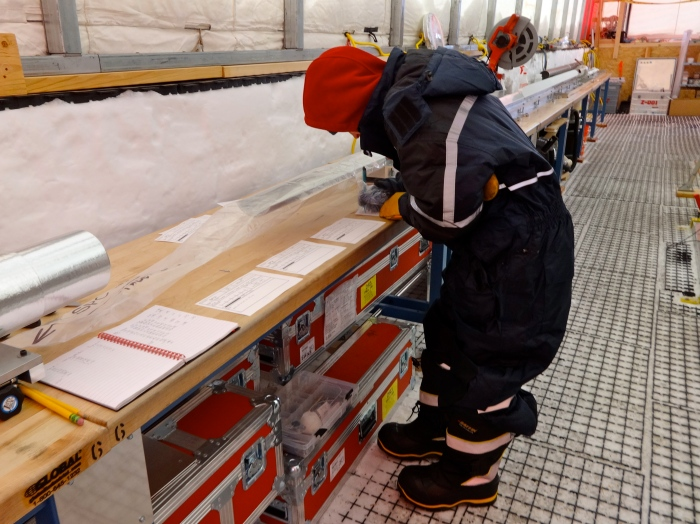 Logging the depth, length, and any special features of the ice core.