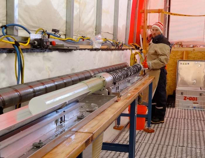 Ice core being removed from the casing.
